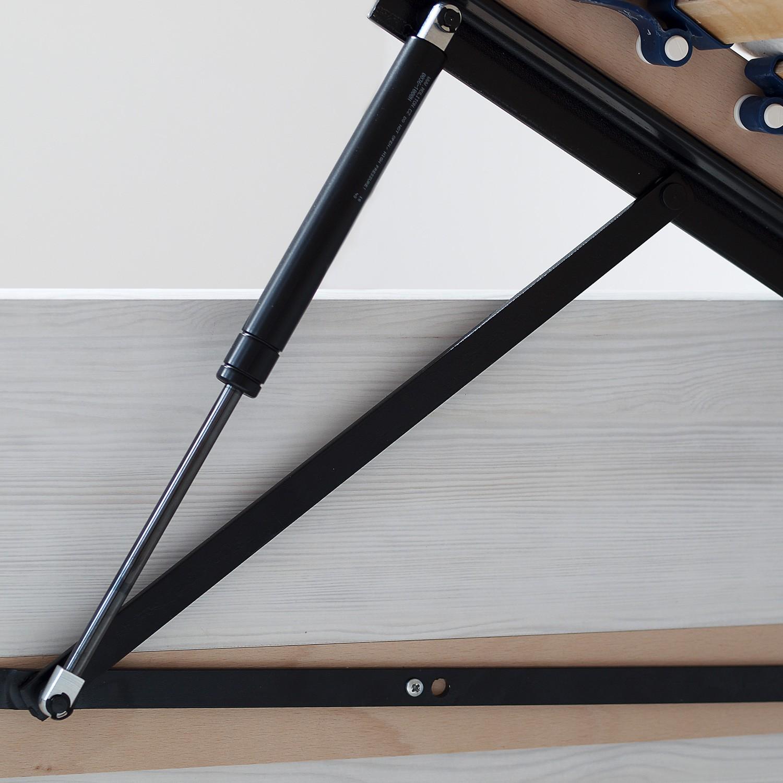 Postel MARIKA KLASIK lamino - detail pístového zdvihového mechanismu u roštu